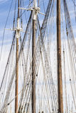 Old Sailing Ship. Masts and furled sails of an old sailing ship in the port of Barcelona Stock Photos