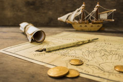 Old sailing ship model and objects over a captain´s cabin Royalty Free Stock Photos