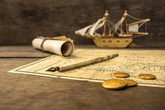 Old sailing ship model and objects over a captain´s cabin Stock Photos