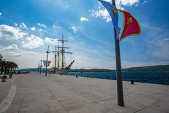 Old sailing ship at the quay. Tivat, Montenegro. Spring daytime scenery view of an old sailing ship at Adriatic Sea quay of the beautiful luxury town of Tivat stock photos