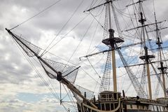 An old sailing ship without sails at the pier. stock photography