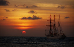 Old sailing ship in the sea at sunset Royalty Free Stock Photo