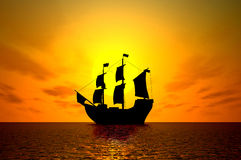 Old sailing ship at sunset. Side view of silhouetted old sailing ship on sea with orange sunset background Stock Image