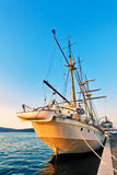 Old sailing ship in sunset light Stock Images