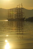 Old sailing ships in the harbor at dawn Royalty Free Stock Photos