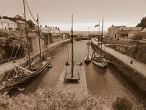 Old sailing ships in harbour. Old sailing ships in the harbour at Charlestown in Cornwall, England stock photography