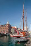 Old sailing ships and houses in Nyhavn in Copenhagen Royalty Free Stock Photo