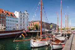 Old sailing ships and houses in Nyhavn in Copenhagen Stock Photo
