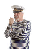Old sailor man smokes pipe Royalty Free Stock Photo