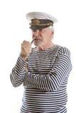 Old sailor man smokes pipe Royalty Free Stock Photo