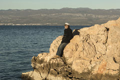 Old sailor waiting for his ship Royalty Free Stock Photography