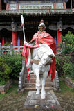 Old saint. On the horseback near temple iin Lijiang, China Stock Image