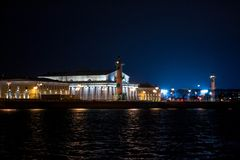Old Saint Petersburg Stock Exchange, Rostral Columns and golden spire of Admiralty Building at Neva river on sunset, Russia.  royalty free stock image