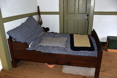 Old Salem, NC: Bedroom at 1771 Miksch House Royalty Free Stock Photo