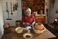 Old Salem, NC: Woman Sewing in Miksch House Kitchen Stock Images