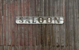 Old Saloon Sign. On Weathered Wood Wall Royalty Free Stock Photos