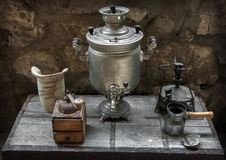 Old samovar, coffee grinder, oil lamp, coffee maker Stock Image