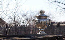Old samovar on grungy wooden table Royalty Free Stock Photo