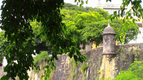 At the Old San Juan Gate. View through some tree branches of the wall along the Old San Juan Gate in Puerto Rico Royalty Free Stock Photo