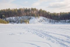 Old sand quarry and tower at city Ogre. Travel photo. 2018. City Ogre, Latvia. Peoples and old sand quarry at city Ogre. Snow and ice, nature photo. Travel photo Stock Photos