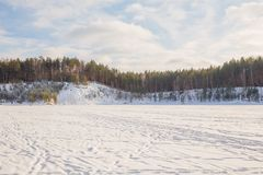 Old sand quarry and tower at city Ogre. Travel photo. 2018. City Ogre, Latvia. Peoples and old sand quarry at city Ogre. Snow and ice, nature photo. Travel photo Stock Image