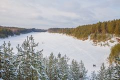 Old sand quarry and tower at city Ogre. Travel photo. 2018. City Ogre, Latvia. Peoples and old sand quarry at city Ogre. Snow and ice, nature photo. Travel photo Stock Photography