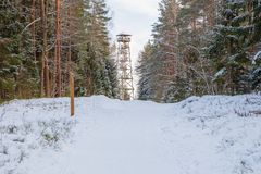 Old sand quarry and tower at city Ogre. Travel photo. 2018. City Ogre, Latvia. Peoples and old sand quarry at city Ogre. Snow and ice, nature photo. Travel photo Stock Photo