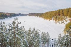 Old sand quarry and tower at city Ogre. Travel photo. 2018. City Ogre, Latvia. Peoples and old sand quarry at city Ogre. Snow and ice, nature photo. Travel photo Royalty Free Stock Photography