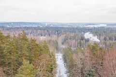 Old sand quarry and tower at city Ogre. Travel photo. 2018. City Ogre, Latvia. Peoples and old sand quarry at city Ogre. Snow and ice, nature photo. Travel photo Royalty Free Stock Images