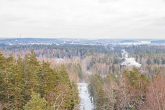 Old sand quarry and tower at city Ogre. Travel photo. 2018. City Ogre, Latvia. Peoples and old sand quarry at city Ogre. Snow and ice, nature photo. Travel photo Royalty Free Stock Photos