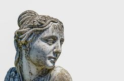 Sand stone beautiful lady face sculpture isolated on white background. A old Sand stone beautiful lady face sculpture isolated on white background royalty free stock image
