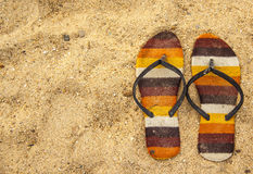 Old sandal on the sand. Top view Royalty Free Stock Photography
