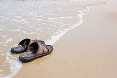 Old sandals on the beach Stock Photography