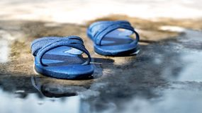 Old sandals on the concrete floor. Royalty Free Stock Photography