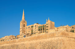 An old sandstone church and houses in Valetta, Malta Royalty Free Stock Images