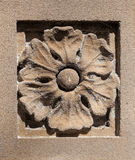Old Sandstone Sculpted Flower with LIchen and Spiderwebs Royalty Free Stock Photography