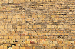 Old sandy brick wall Stock Image