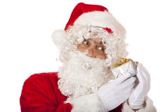 Old Santa Claus is listening a Christmas present Stock Images