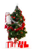 Old Santa Claus looking over tree isolated on white Stock Photo
