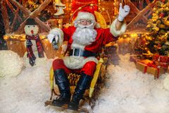 Old santa sits in chair. Santa Claus sitting on his armchair and watching a Christmas movie. Entertainment and cinema concept. santa claus and Happy New Year stock image