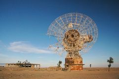 Old Satalite dish in blue sky. Old Satalite dish dameged by saddam husain in gulf war 1990 in blue sky Stock Image