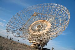 Old Satalite dish in blue sky. Old Satalite dish dameged by saddam husain in gulf war 1990 in blue sky Royalty Free Stock Photo
