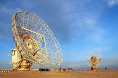 Old Satalite dish in blue sky. Old Satalite dish dameged by saddam husain in gulf war 1990 in blue sky Stock Photography