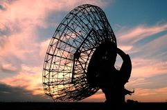 Old Satalite dish in Orang sky. Satalite dish with sun in kuwait Stock Photos
