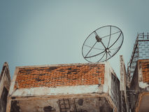 Old Satellite disc against blue sky Royalty Free Stock Photography