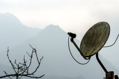 The old Satellite dish in the mountain. Royalty Free Stock Image