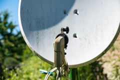Old satellite dish standing in a garden Stock Photography