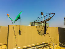 Old satellite dishes on concrete deck top roof floor of the old Stock Photo
