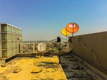 Old satellite dishes on concrete deck top roof floor of the old Royalty Free Stock Images
