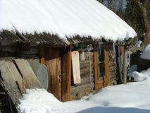 Old sauna building (Siberia). Old sauna building covered up with snow (Siberia Royalty Free Stock Photo